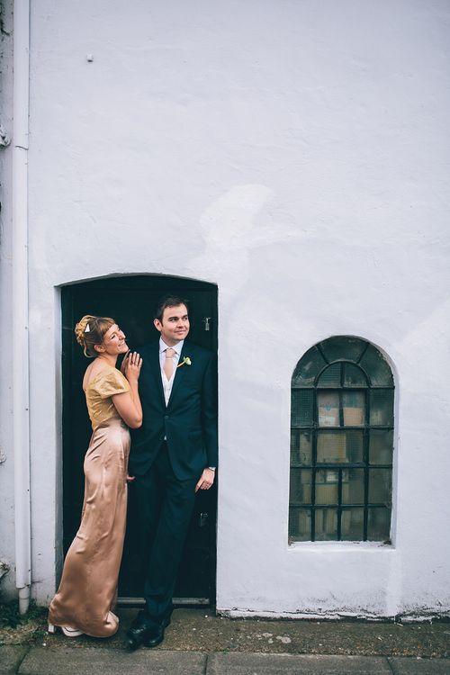 Bride in Bespoke Gold Gown & Groom in Moss Bros Hire Suit