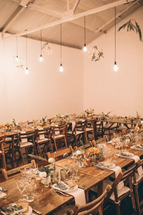 Rustic Trestle Tables with Industrial Lighting, Geometric Terrarium Decor & Autumnal Blooms