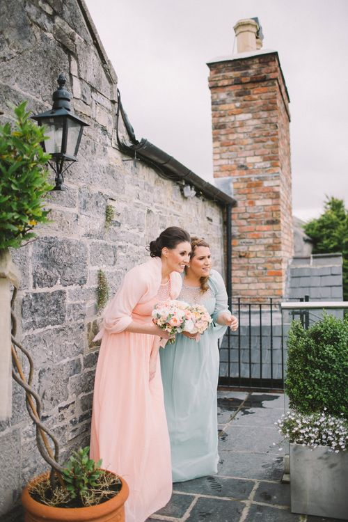 Bridesmaids in Pastel Peach & Green Gowns