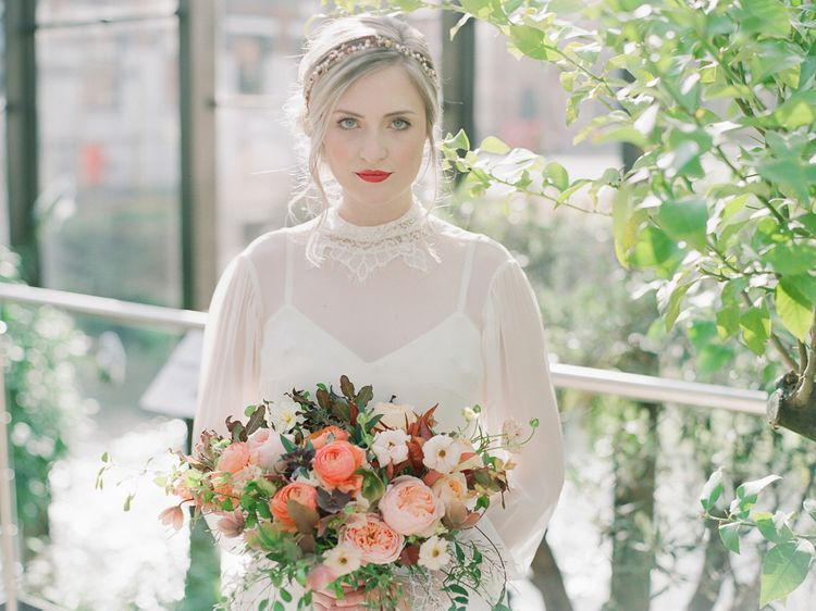 Beautiful Bride With Bright Red Lip And Soft Up Do