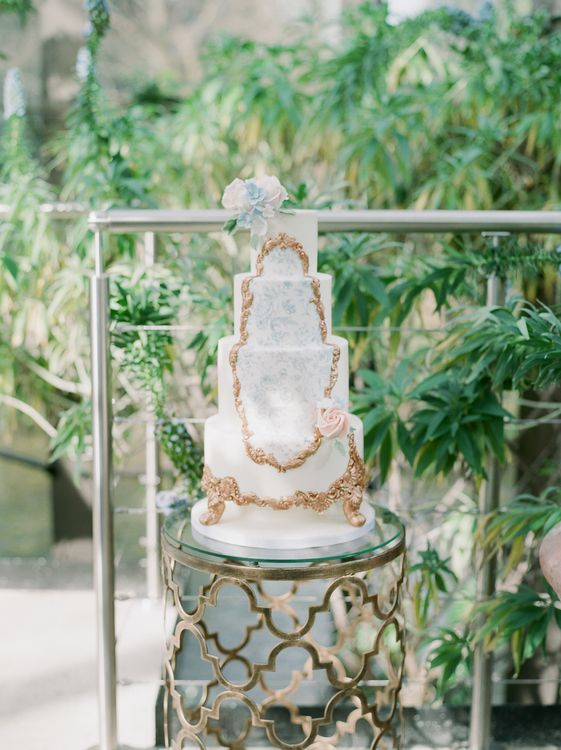 Ornate Wedding Cake With Gold Icing Detail