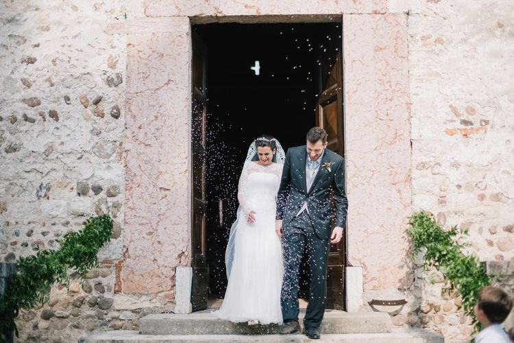 Confetti Exit | Bride in Couture Hayez Wedding Dress | Groom in Traditional Wedding Suit | Bright Woodland Wedding in Italy Planned & Styled by Le Jour du Oui | Infraordinario Wedding Photography | Mani Films