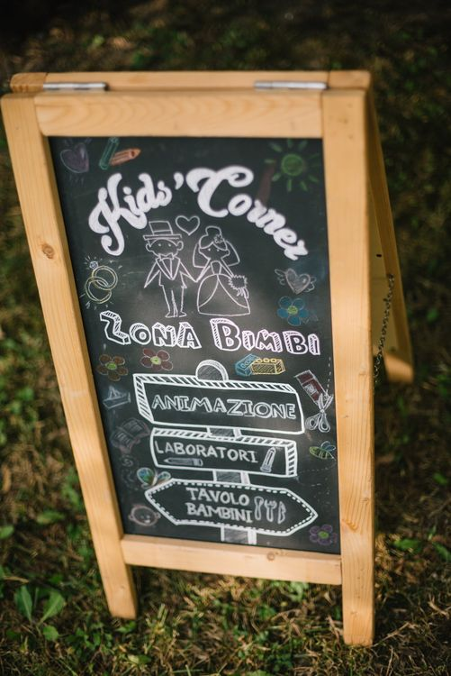 Chalkboard Wedding Sign | Children's Play Area | Bright Woodland Wedding in Italy Planned & Styled by Le Jour du Oui | Infraordinario Wedding Photography | Mani Films