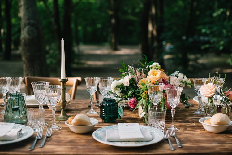 Wedding Table Scape with Bright Flowers & Decorative Crockery | Bright Woodland Wedding in Italy Planned & Styled by Le Jour du Oui | Infraordinario Wedding Photography | Mani Films