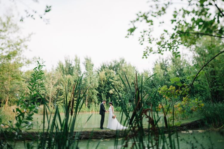 Bride in Couture Hayez Wedding Dress | Groom in Traditional Wedding Suit | Bright Woodland Wedding in Italy Planned & Styled by Le Jour du Oui | Infraordinario Wedding Photography | Mani Films