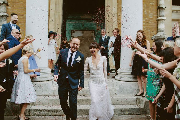 Confetti Exit | Bride in Preowned Lace Inbal Dror Wedding Dress | Groom in Gieves & Hawkes Suit | David Jenkins Photography