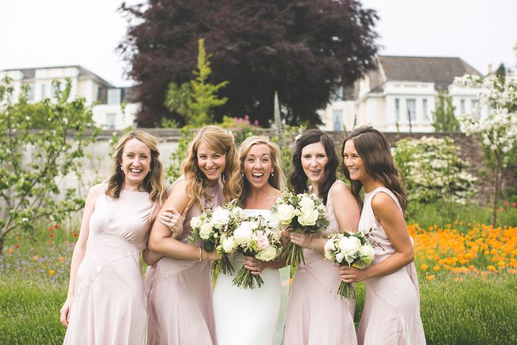 Bridesmaids In Pink Ghost Dresses