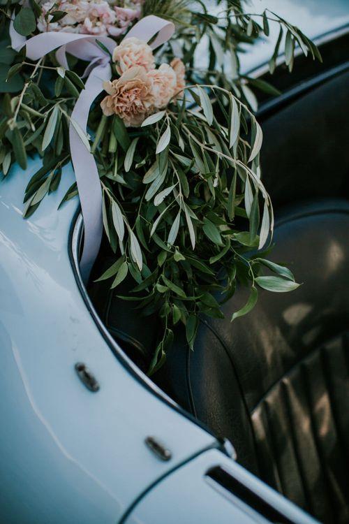 Flowers on Vintage Wedding Car   D&A Photography   Ben Walton Films