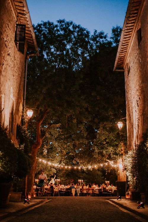 Festoon Lit Outdoor Reception   Bride in Morgan Davies Gown   Groom in Suit Supply   D&A Photography   Ben Walton Films