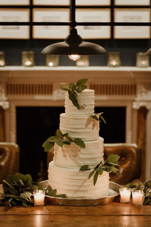 Buttercream Wedding Cake With Foliage Image By The Curries