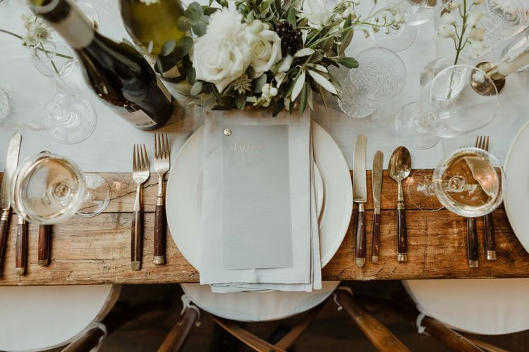 Wooden Trestle Tables With Soft Grey Runners, Taper Candles And White Florals For Wedding Image By The Curries