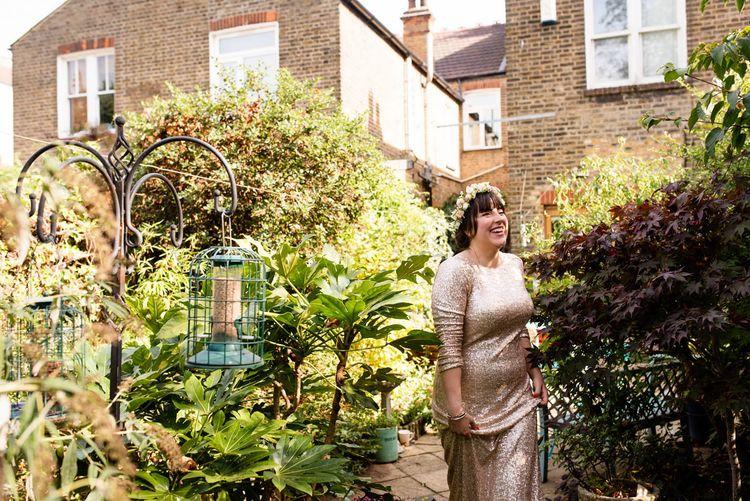Bride in Pre Owned Gold Sequin Badgley Mischka Wedding Dress