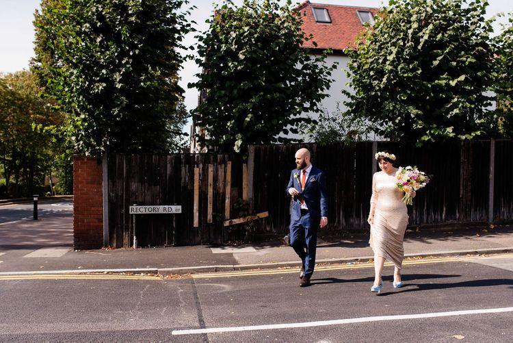 Bride in Pre Owned Gold Sequin Badgley Mischka Wedding Dress & Groom in Suit Supply