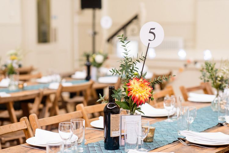 Hand Picked Flower Stems in Vases as Table Centrepieces
