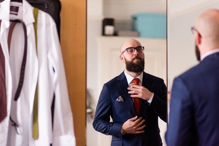 Groom in Suit Supply Wedding Suit