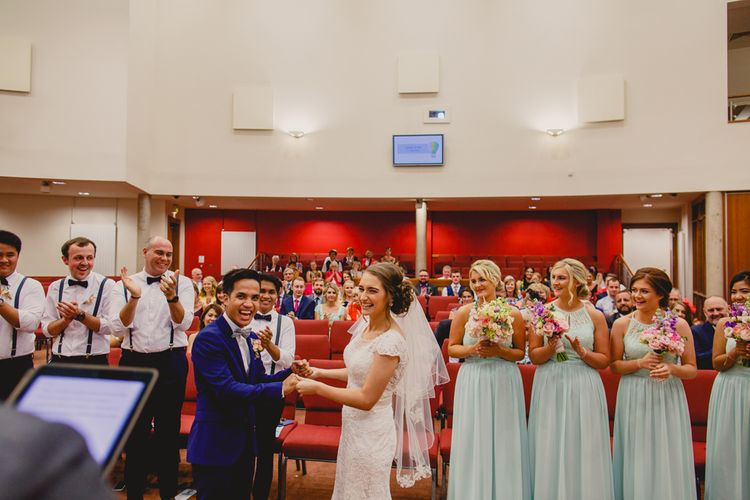 Religious Wedding Ceremony   Bride in Lace Dress   Groom in Navy Suit   Navyblur Photography   Cinematic Tide Films