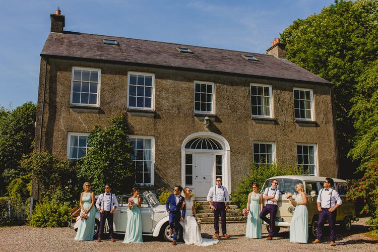 Wedding Party Outside Breckenhill Wedding Venue   Navyblur Photography   Cinematic Tide Films