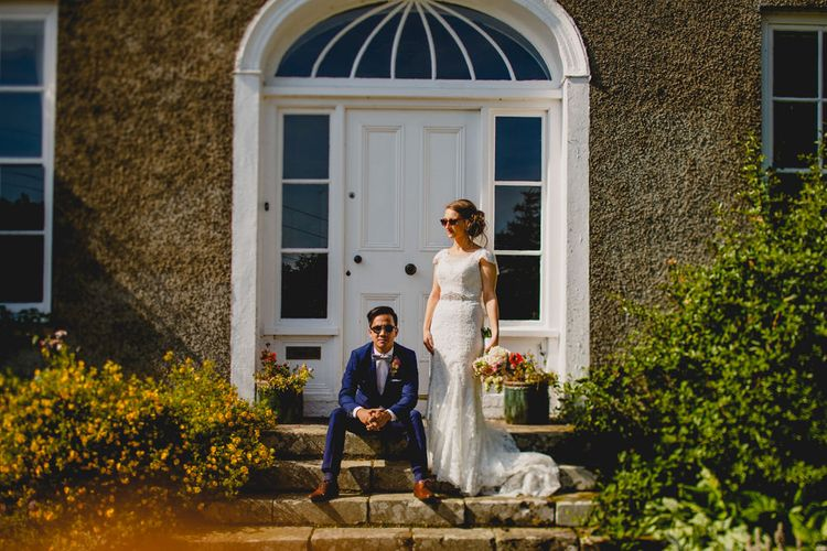 Bride in Lace Dress from Vintage Rose Bridal   Groom in H&M Navy Blue Suit   Navyblur Photography   Cinematic Tide Films
