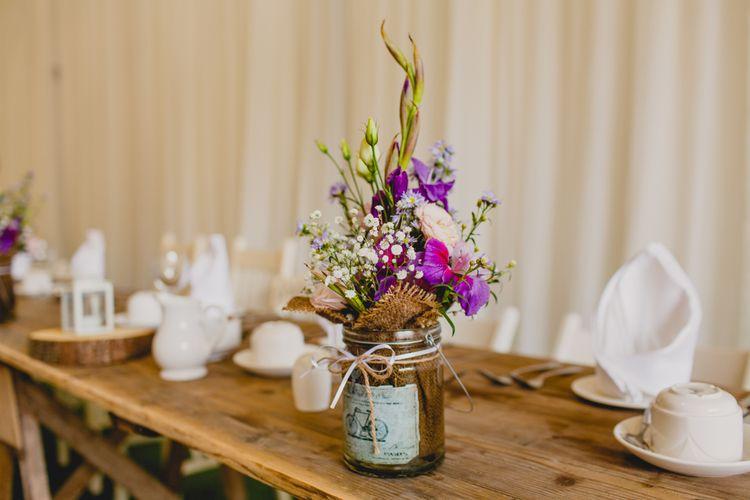 Flowers in Jars Wedding Decor   Navyblur Photography   Cinematic Tide Films