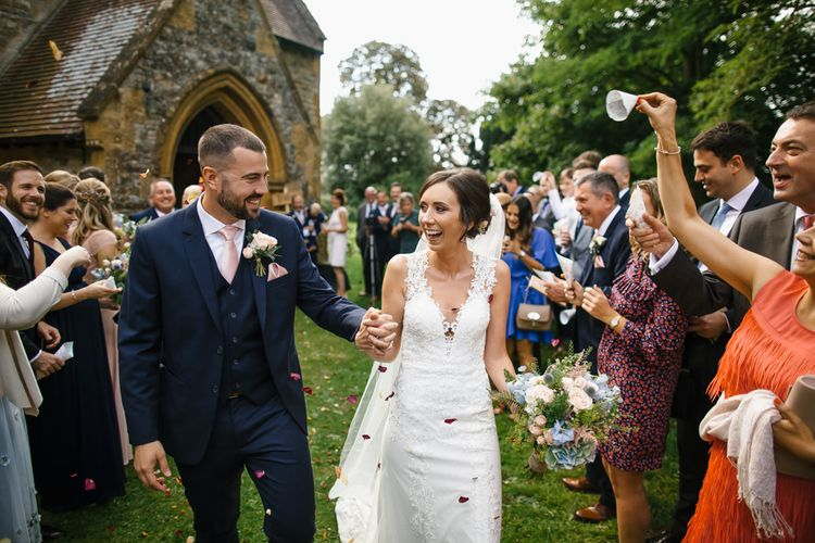 Confetti Exit | Bride in Lace Sincerity Gown | Groom in Navy Suit | DIY Country Pub Wedding at The Bell in Alderminster, Stratford-upon-Avon | Chris Barber Photography