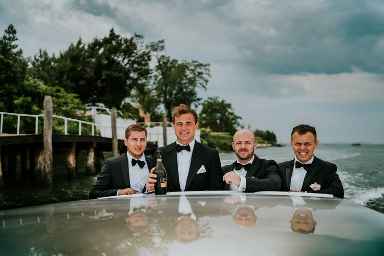 Boat Ride | Groomsmen in Black Tuxedos | Super Luxe Greek Wedding at The Cipriani in Venice | Bridgwood Wedding Photography