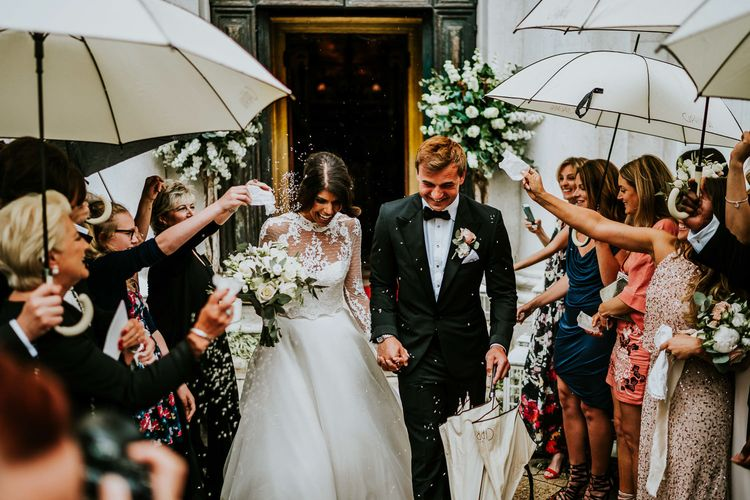 Confetti Moment | Bride in Romona Keveza Gown | Groom in Black Tuxedo | Super Luxe Greek Wedding at The Cipriani in Venice | Bridgwood Wedding Photography