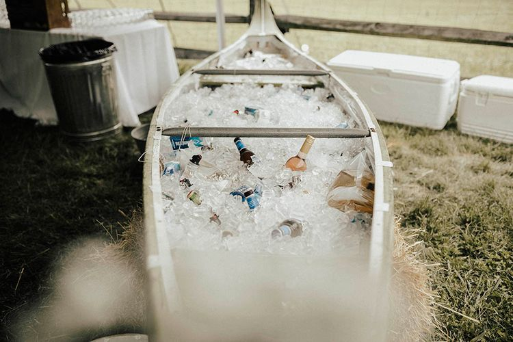 Canoe Filled With Beer For Wedding | Jenny Yoo Bride For An Outdoor Farm Wedding In Maryland USA With Bridesmaids In Mismatched Dresses & Images From Erin Krespan