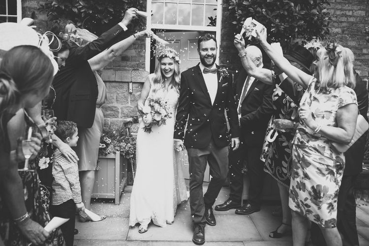 Confetti Moment with Bride in Bespoke Mariée Wedding Dress & Groom in Slater Jacket & Topman Chino's by Matt Brown Photography