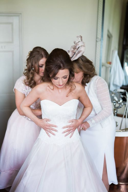 Getting Ready | Bridal Preparations | Bride in Sarah Bussey from Ivory & Co. Gown | Elegant Blush Pink & White Wedding at Aynhoe Park in Oxfordshire | Lucy Davenport Photography