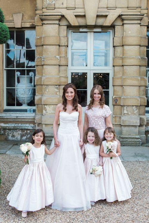 Flower Girls in Nicki MacFarlane Outfits | Bride in Sarah Bussey from Ivory & Co. Gown | Bridesmaid in Pink Coast Sequin Top & High Low Skirt Separates | Elegant Blush Pink & White Wedding at Aynhoe Park in Oxfordshire | Lucy Davenport Photography