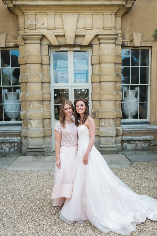 Bride in Sarah Bussey from Ivory & Co. Gown | Bridesmaid in Pink Coast Sequin Top & High Low Skirt Separates | Elegant Blush Pink & White Wedding at Aynhoe Park in Oxfordshire | Lucy Davenport Photography