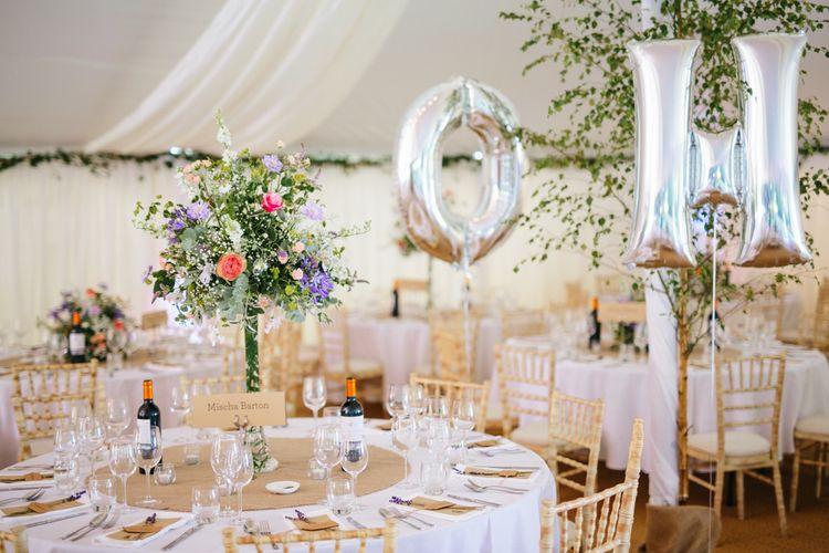 Wedding Reception With Large Wild Flower Arrangements
