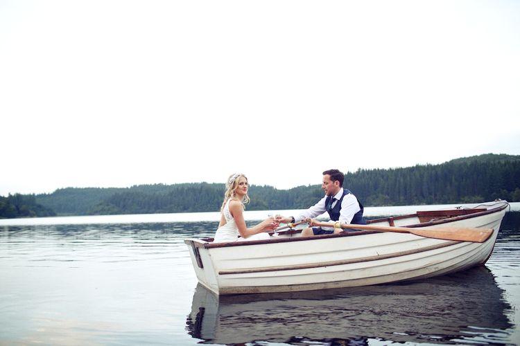 Bride & Groom In Boat On Loch