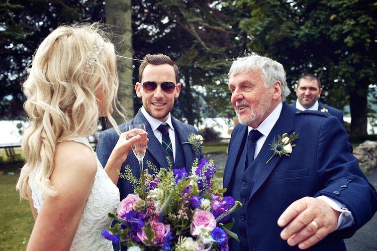 Bride With Purple Wedding Bouquet