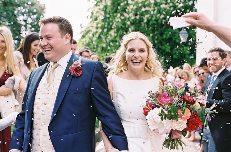 Confetti Moment   Bride in Sassi Holford Gown   Groom in Neal & Palmer Navy Suit   Classic Wedding at Trafalgar Tavern, Greenwich, London   Ann-Kathrin Koch Photography