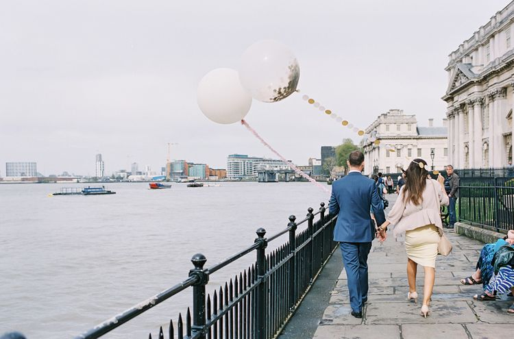 Wedding Guests with Giant Confetti Filled Balloon with Tissue Tassel   Classic Wedding at Trafalgar Tavern, Greenwich, London   Ann-Kathrin Koch Photography