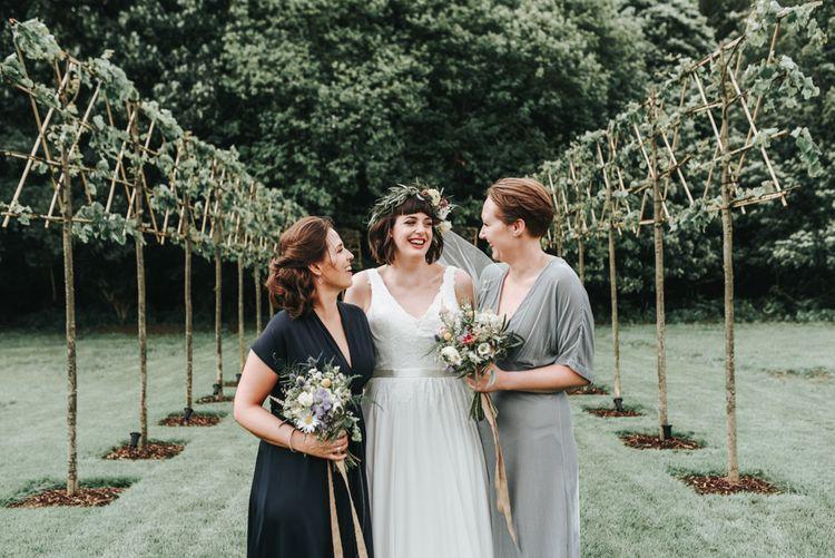 Bridesmaid In Navy & Grey Dresses