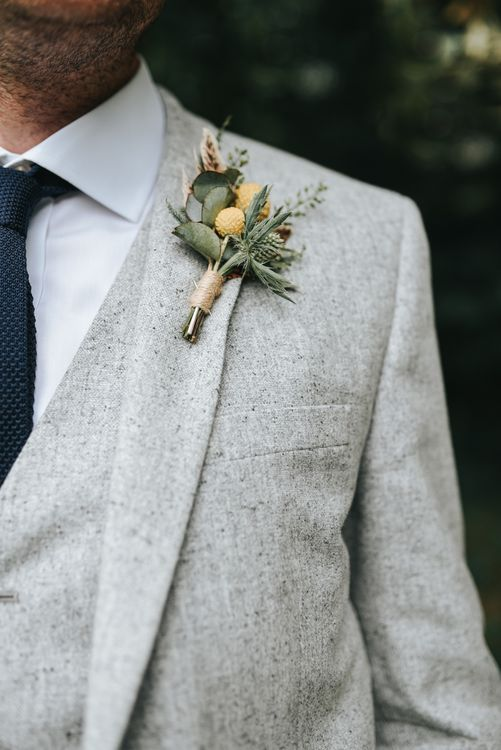 Rustic Buttonhole For Groom In Pale Grey Suit