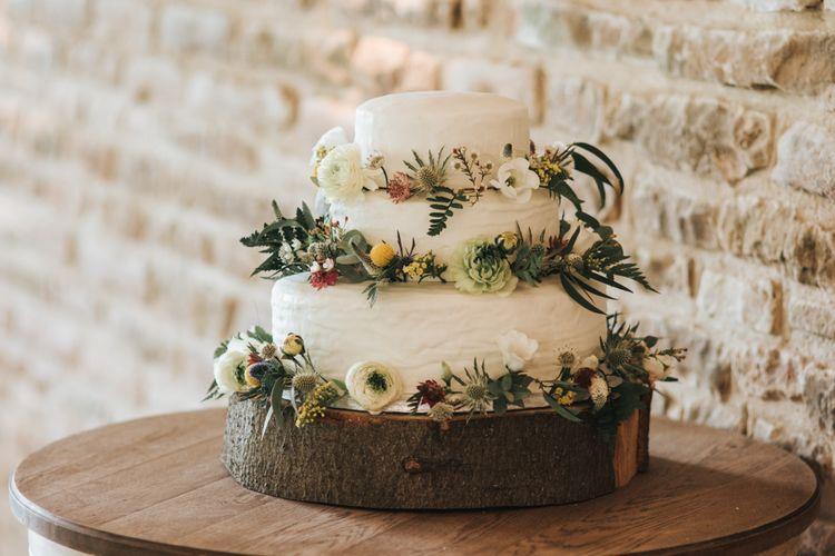 White Wedding Cake With Foliage & Fresh Flowers