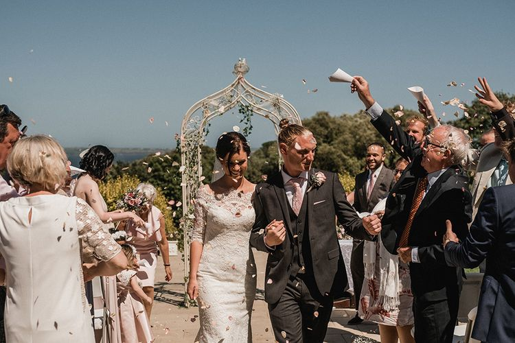 Confetti Moment   Bride in Pronovias Princia Lace Gown & Jacket   Outdoor Wedding at The Haven Hotel in Southern Ireland   Jason Mark Harris Photography