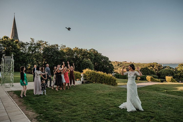Bouquet Toss   Outdoor Wedding at The Haven Hotel in Southern Ireland   Jason Mark Harris Photography