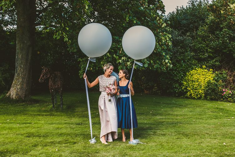 Bride in Separates by Suzannah | Bridesmaids in Navy Chi Chi London Dress | Giant Balloons | Nautical At Home Marquee Wedding by 81 Events | RS Brown Photography