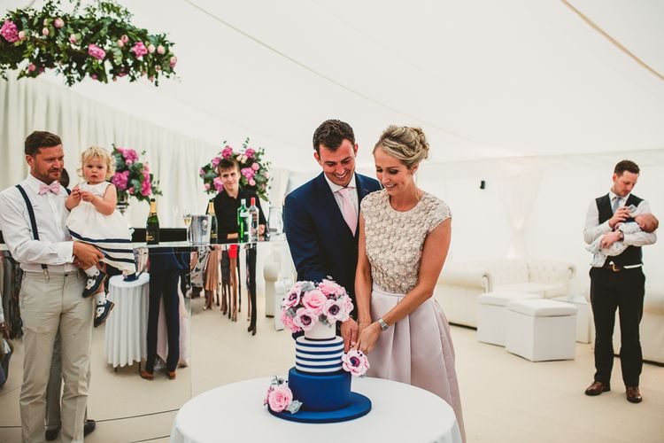 Cutting the Cake | Bride in Separates by Suzannah | Groom in Navy Laurence Menswear Suit | Nautical At Home Marquee Wedding by 81 Events | RS Brown Photography