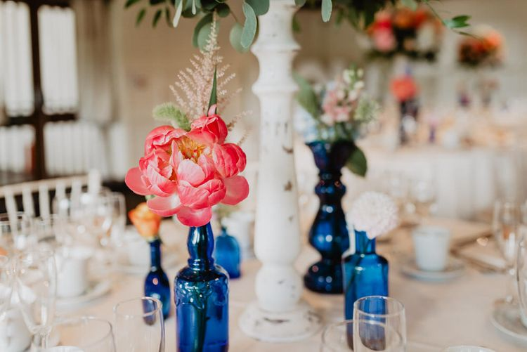 Peonies In Blue Glass Bottles For Wedding