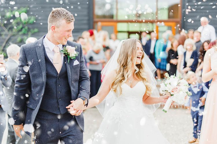 Confetti Moment | Bride in Warren Watters Gown | Groom in Marks and Spencer Suit | Peach & White Wedding at Upwaltham Barns | White Stag Wedding Photography