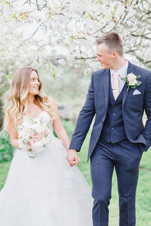 Bride in Warren Watters Gown | Groom in Marks and Spencer Suit | Peach & White Wedding at Upwaltham Barns | White Stag Wedding Photography