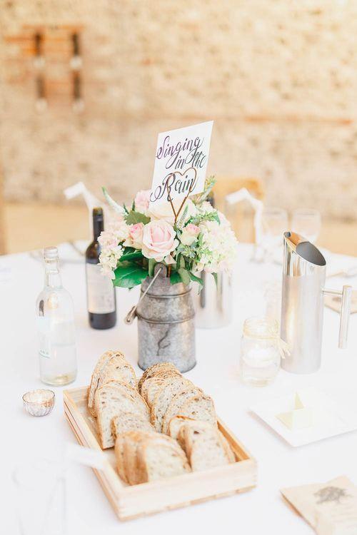 Peach & White Mini Milk Urn Centrepiece | Peach & White Wedding at Upwaltham Barns | White Stag Wedding Photography
