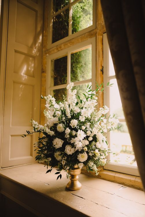 White Floral Display For Wedding // White & Gold Elegant Wedding Decor // Elegant Wedding Brympton House Somerset With Bride Wearing Inbal Dror And Groom In Black Tux By Alexander McQueen With Images From Modern Vintage Weddings