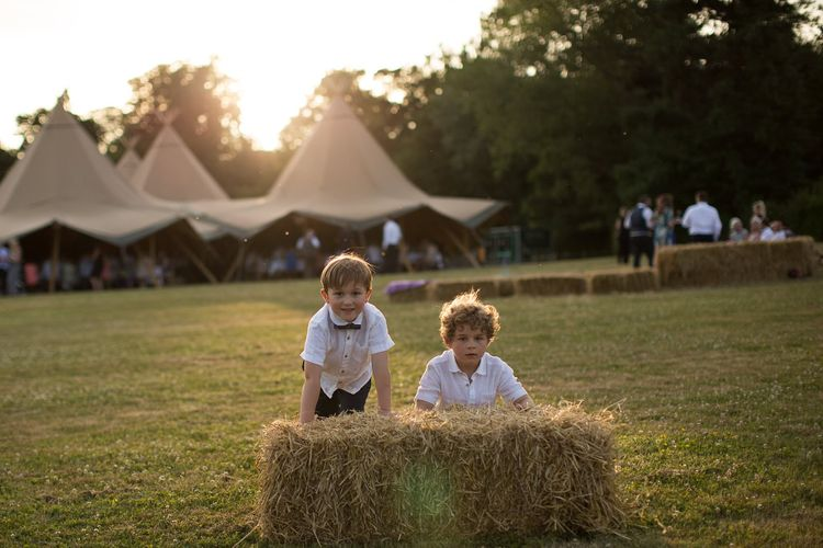 Page Boys at Outdoor Tipi Wedding with Hay Bale Seating