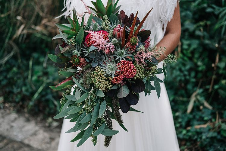 Wedding Bouquet In Rich Berry Tones With Lots Of Foliage
